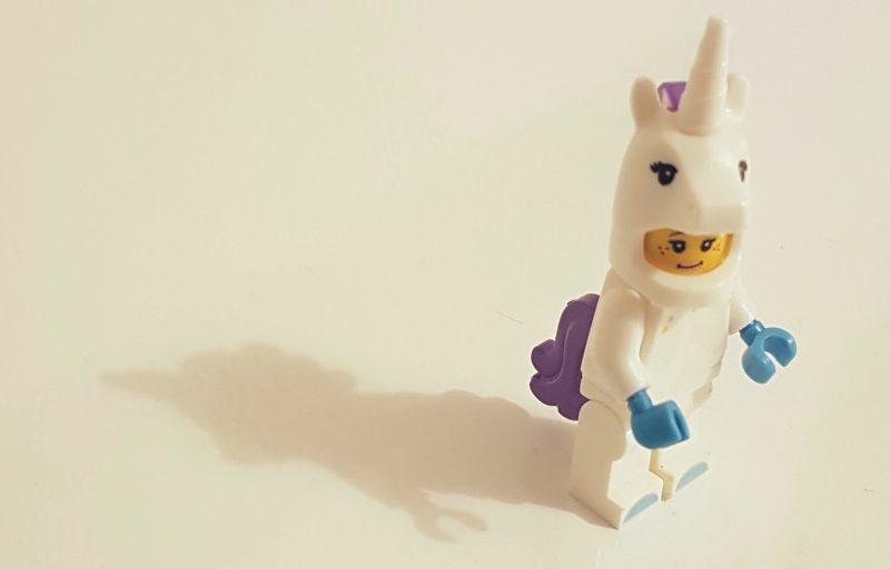 Lego person wearing unicorn suit